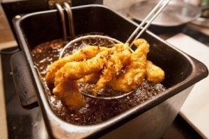 Chicken tenders fried in a deep fryer.